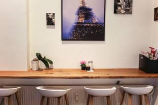 Die Bilder im Café du Bonheur