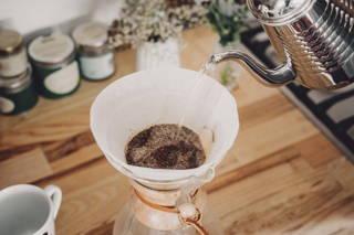 Dampen the ground coffee